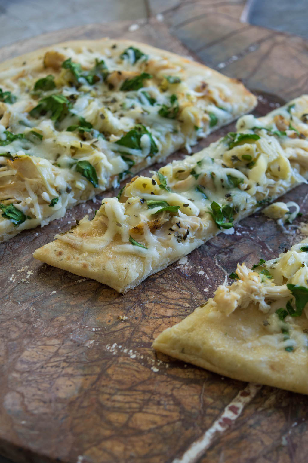 The Alfredo Chicken Mozzarella Flatbread Pizza is easy and everyone's favorite that is satisfying that can be made in a hurry with rotisserie chicken.