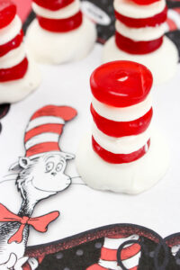 An easy Cat in the Hat Dr. Seuss Treats made with vanilla wafers, white chocolate and red gummy lifesavers in honor Dr. Seuss' birthday.