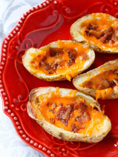 Homemade crispy, cheesy, baked potato skins are the perfect loaded appetizer for any get together that your family and friends will love topped with cheese, bacon, and sour cream.