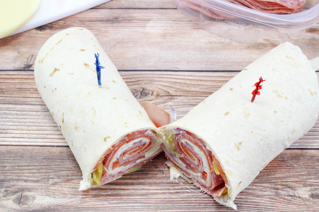 These Italian roll-ups aka tortilla roll-ups, ham pinwheels, or appetizer roll-ups, they are so easy to make and make a great lunch or appetizer. Use your favorite ham, salami, turkey, pepperoni and cheeses to make these your own.