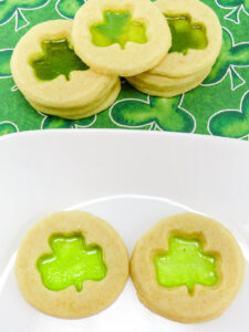 Leprechauns, Rainbows and Shamrocks are a staple in our house this time of year. The Jolly Rancher Stained Glass Shamrock Cookies Recipe are colorful, flavorful and fun and perfect for St. Patrick's Day. No one can turn down a stained glass cookie.