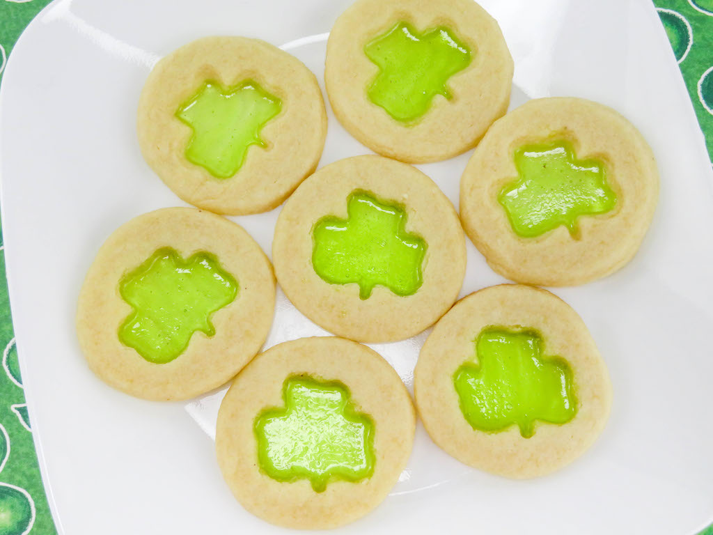 The Jolly Rancher Stained Glass Shamrock Cookies Recipe are colorful, flavorful, fun and perfect for St. Patrick's Day. No one can turn down a stained glass cookie.