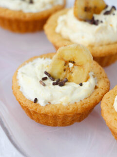 Mini cream pie recipes are always fun but a blend of banana cream and sugar cookies all rolled into an easy bite sized Banana Cream Pie Cookie Cups recipe makes it even better.
