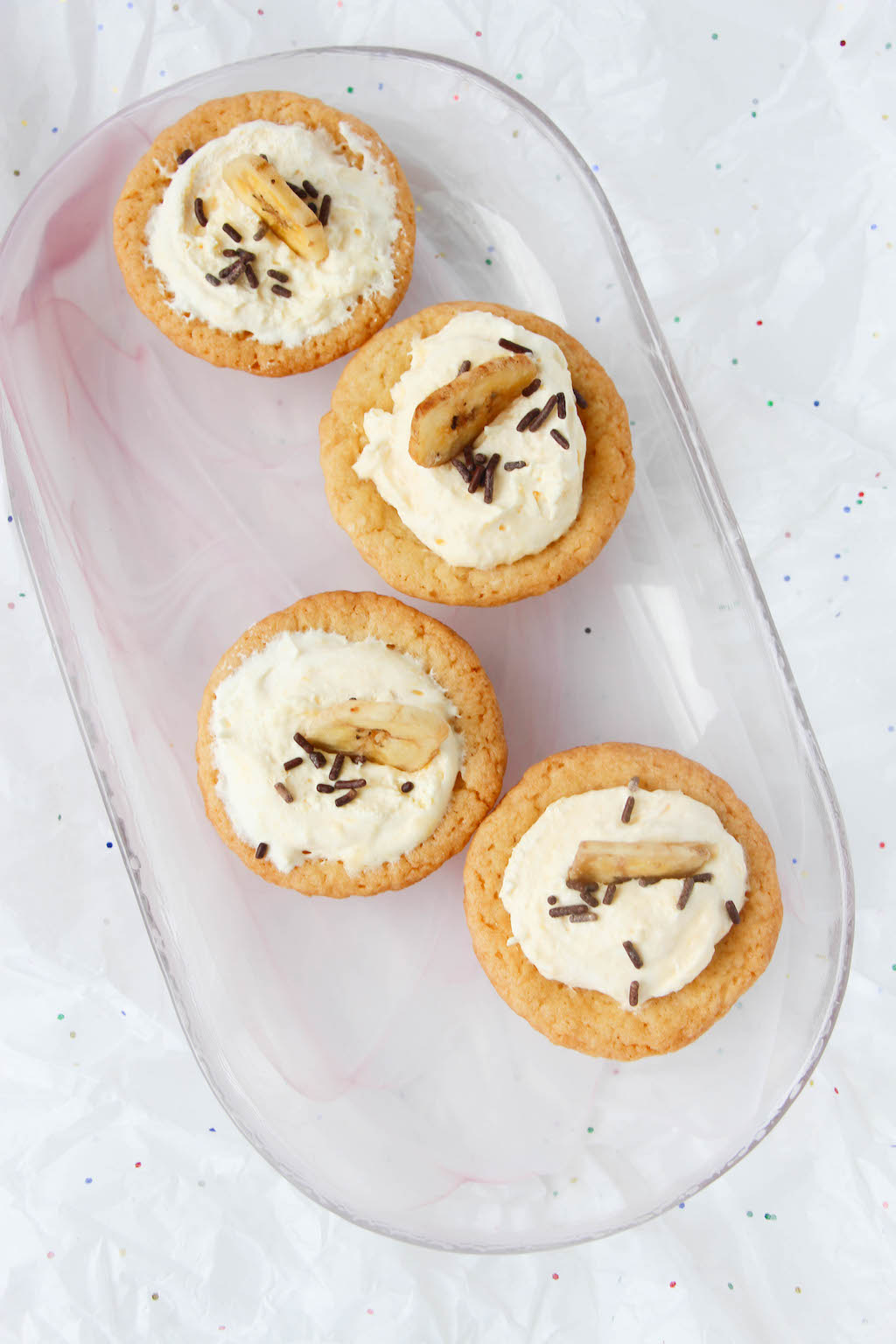 Mini cream pie recipes are always fun but a blend of banana cream and sugar cookies all rolled into an easy bite sized Banana Cream Cookie Cups recipe makes it even better.