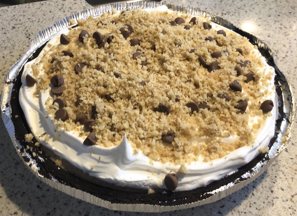 Caramel Creams® Turtle Ice Cream Pie is a delicious, mouth watering pie made with Caramel Creams®, Chocolate, Pecans, no churn caramel ice cream all rolled into a chocolate crust and topped with whip cream. Is your mouth watering yet just thinking about it?