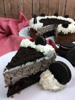 This is by far the best Baked Oreo Cheesecake recipe ever and just in time for National Oreo Cookie Day! A chocolate cake layered with an Oreo Cheesecake filling and topped with whipped cream and more Oreo's.