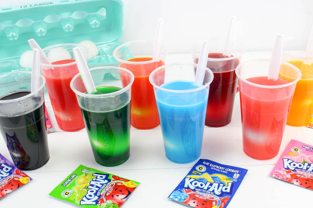 eggs sitting in kool-aid cups