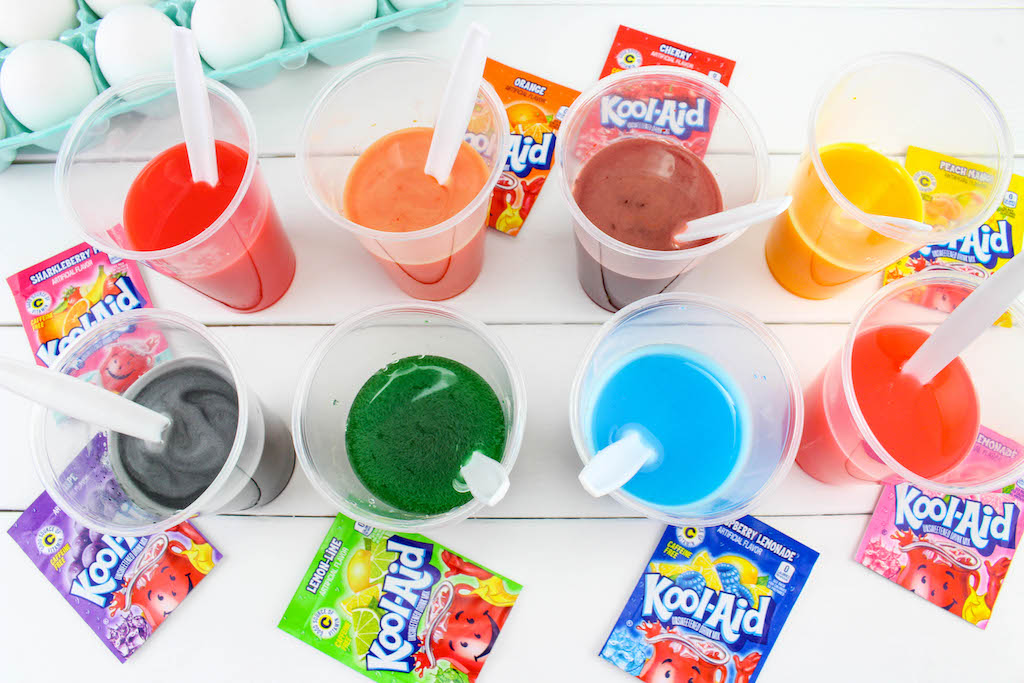 This post explains how easy and inexpensive it is to dye Easter eggs with Kool-Aid. It's so much more fun than a regular egg dye kit. #EasterEggs #KoolAid #EasterTraditions