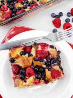Made with fresh raspberries and blueberries, the Berry Croissant Breakfast Casserole Recipe can be used as a dessert and even makes a great breakfast on Christmas morning.
