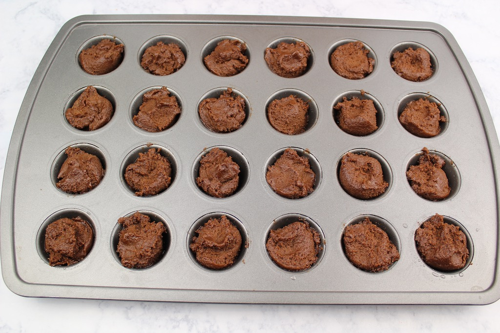 add cookie dough into muffin tin