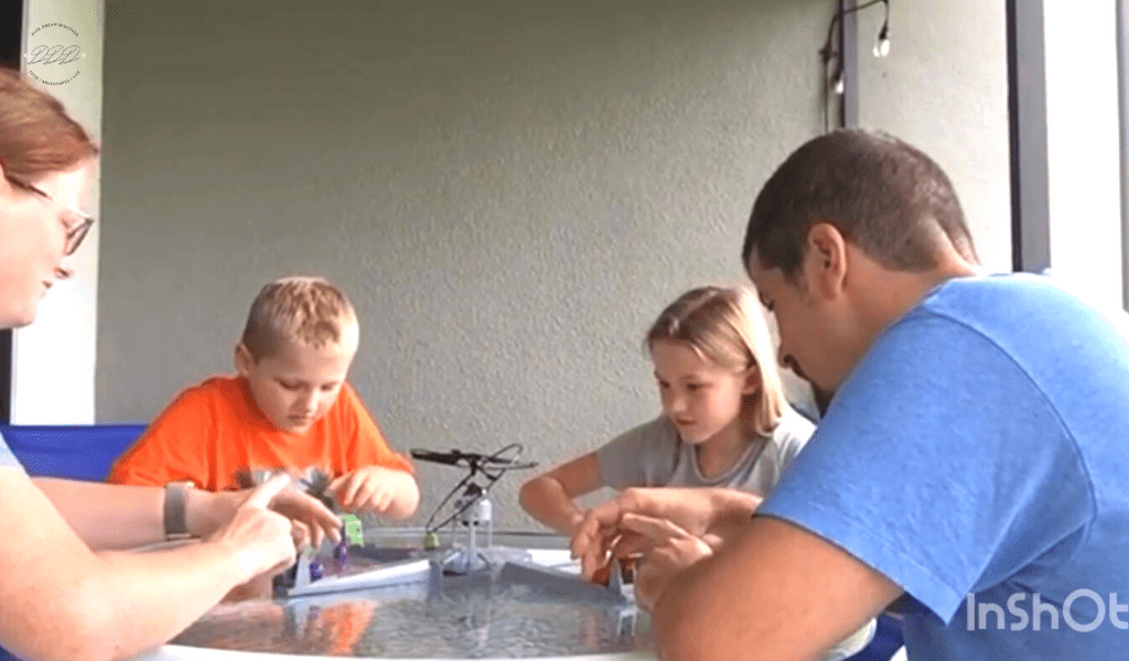 family playing drone home