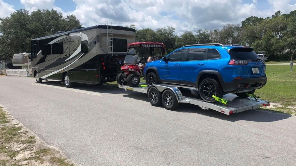rv with car trailer